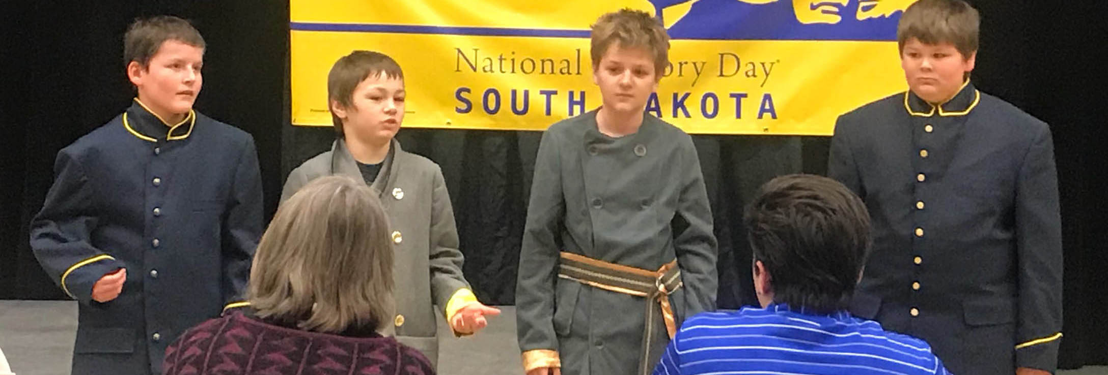 """""Three NHD in SD students being interviewd about their historical performance by judges."""""