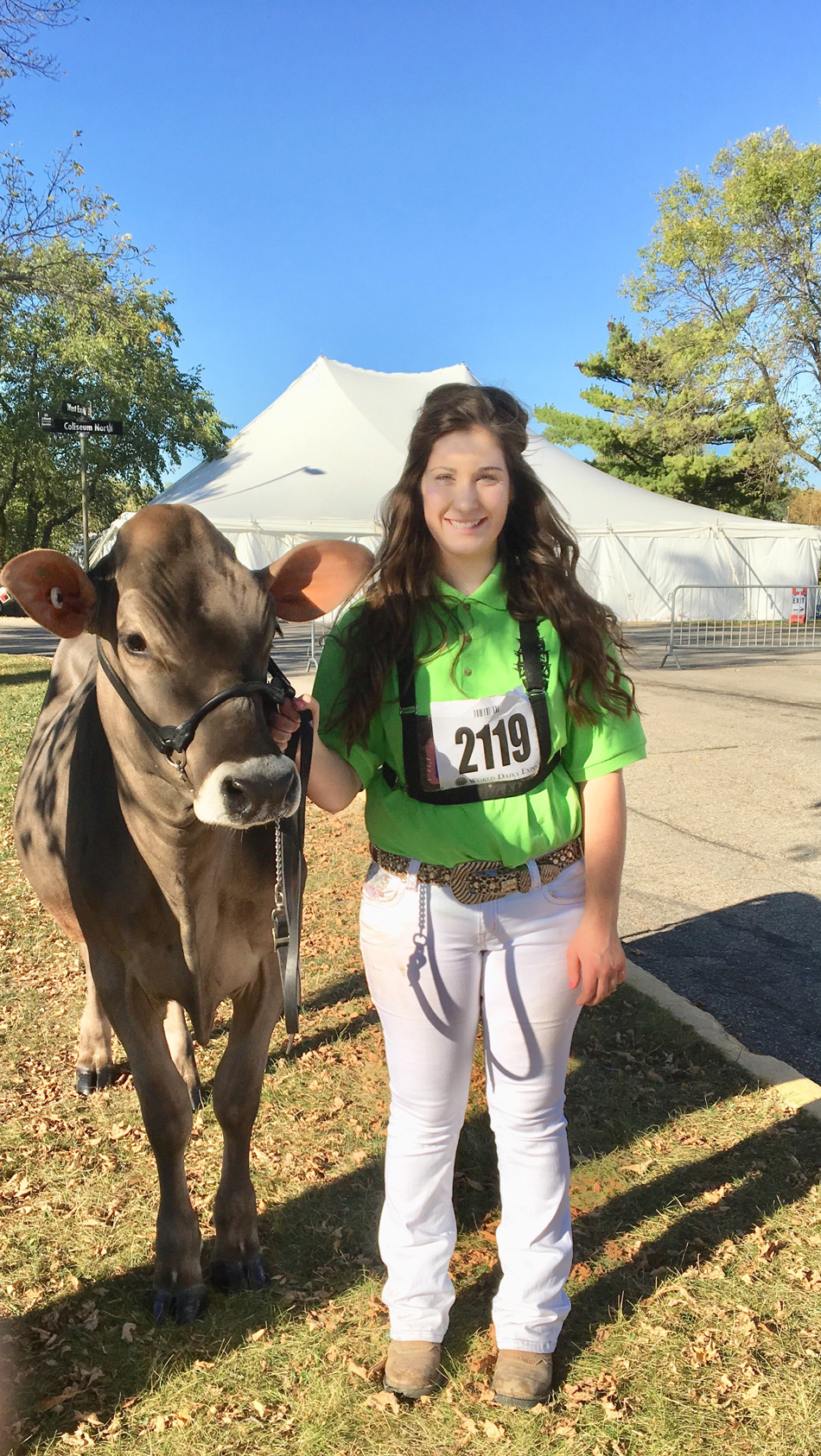 Laura Frye with a Brown Swiss cow