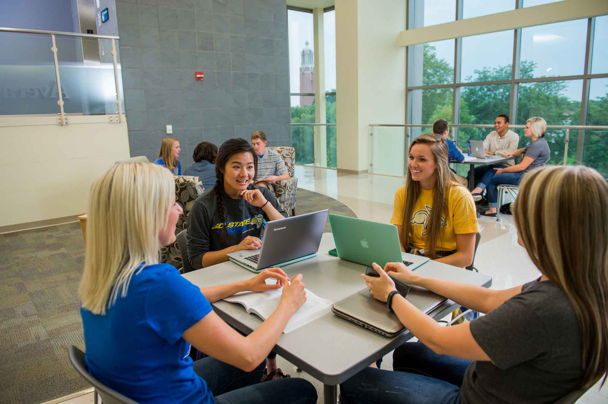 Students at table in Avera building lounge