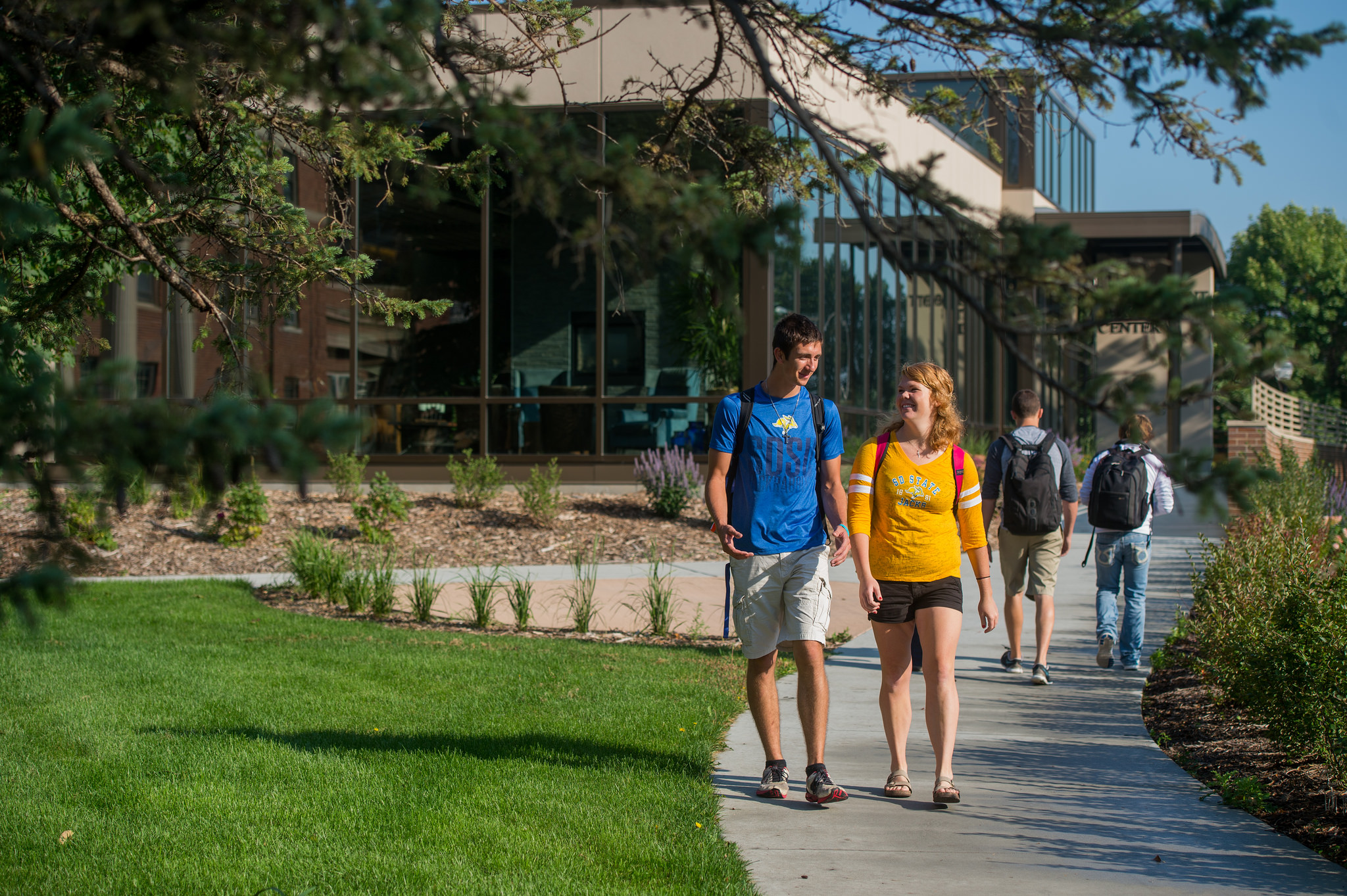 Students walking outside the Enrollment Services Center