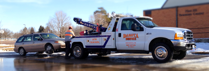 Dakota Services Company Tow Truck towing away a vehicle