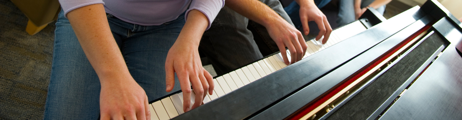 Two students play the piano