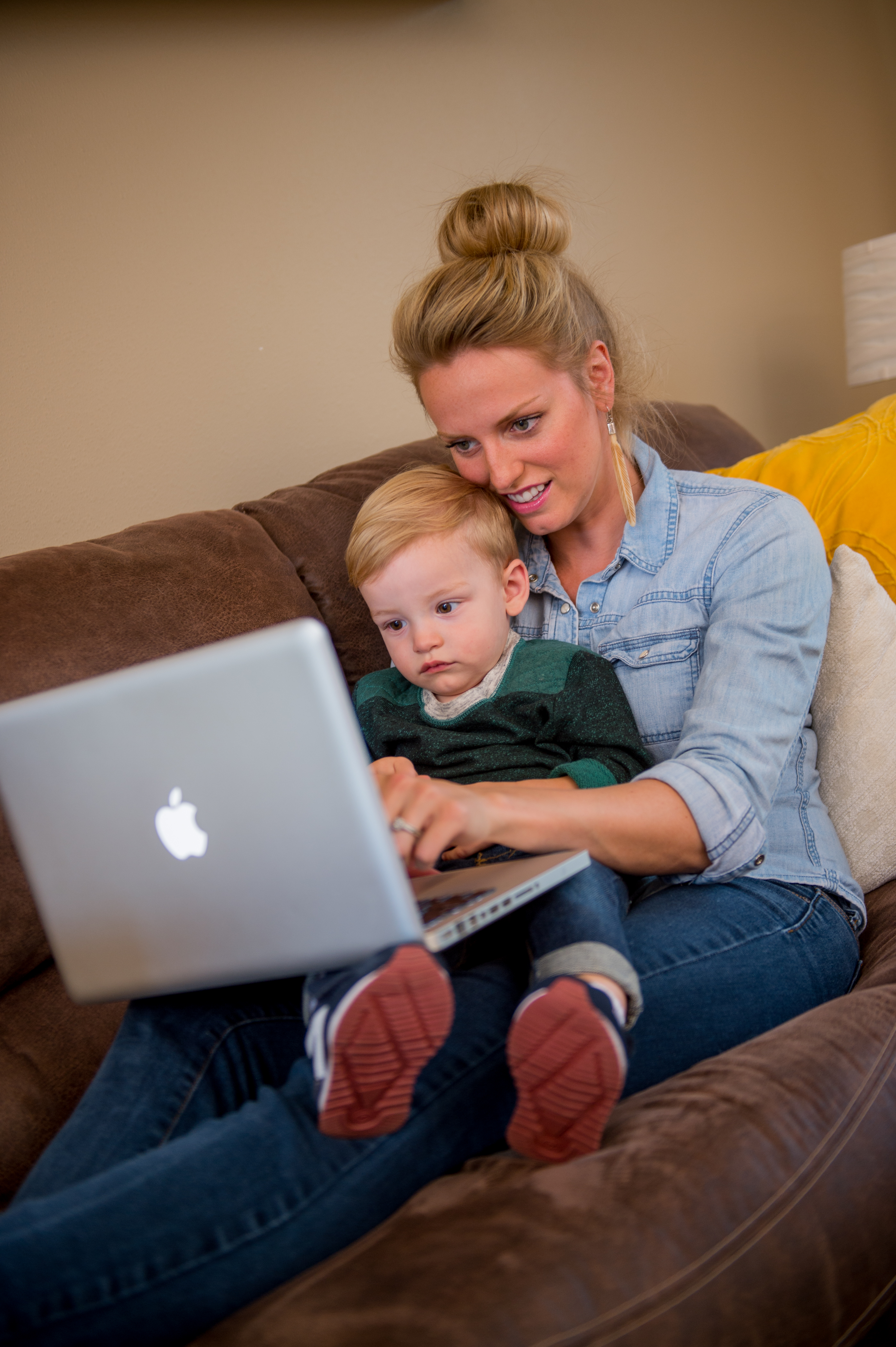 Mom with child taking online classes from SDSU