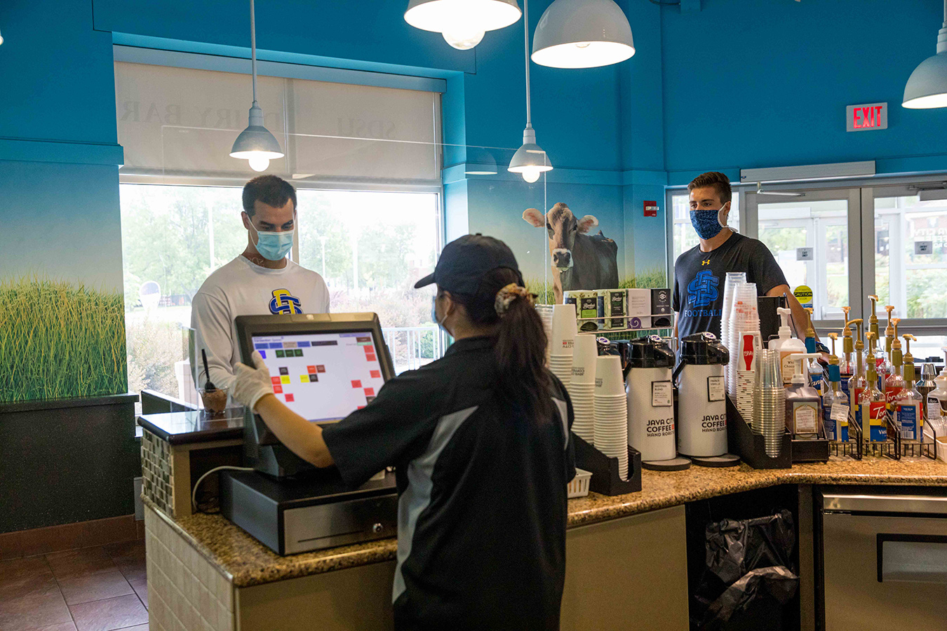 Students wearing face masks while visiting the Dairy Bar