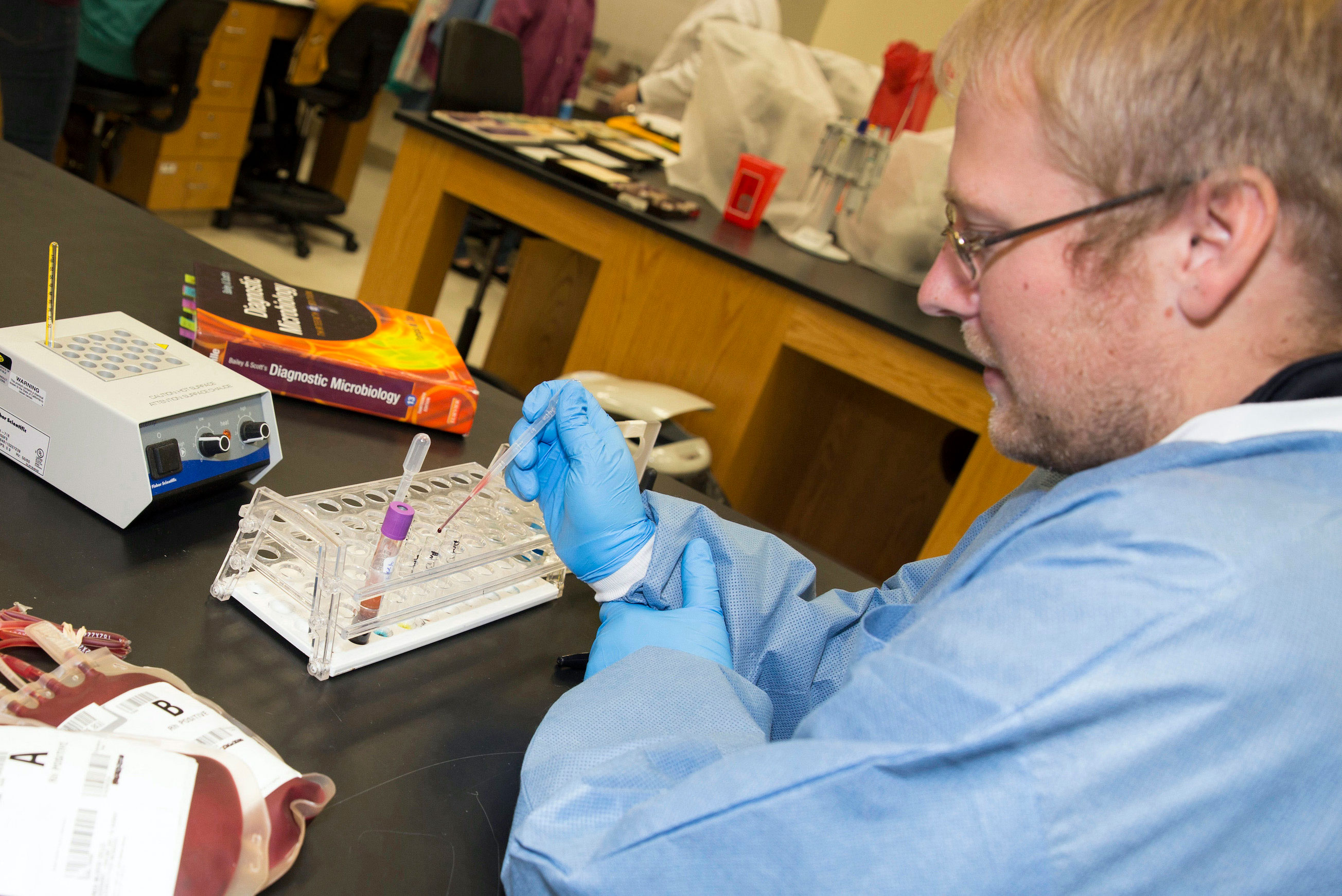 Medical Laboratory Science student working with samples in lab