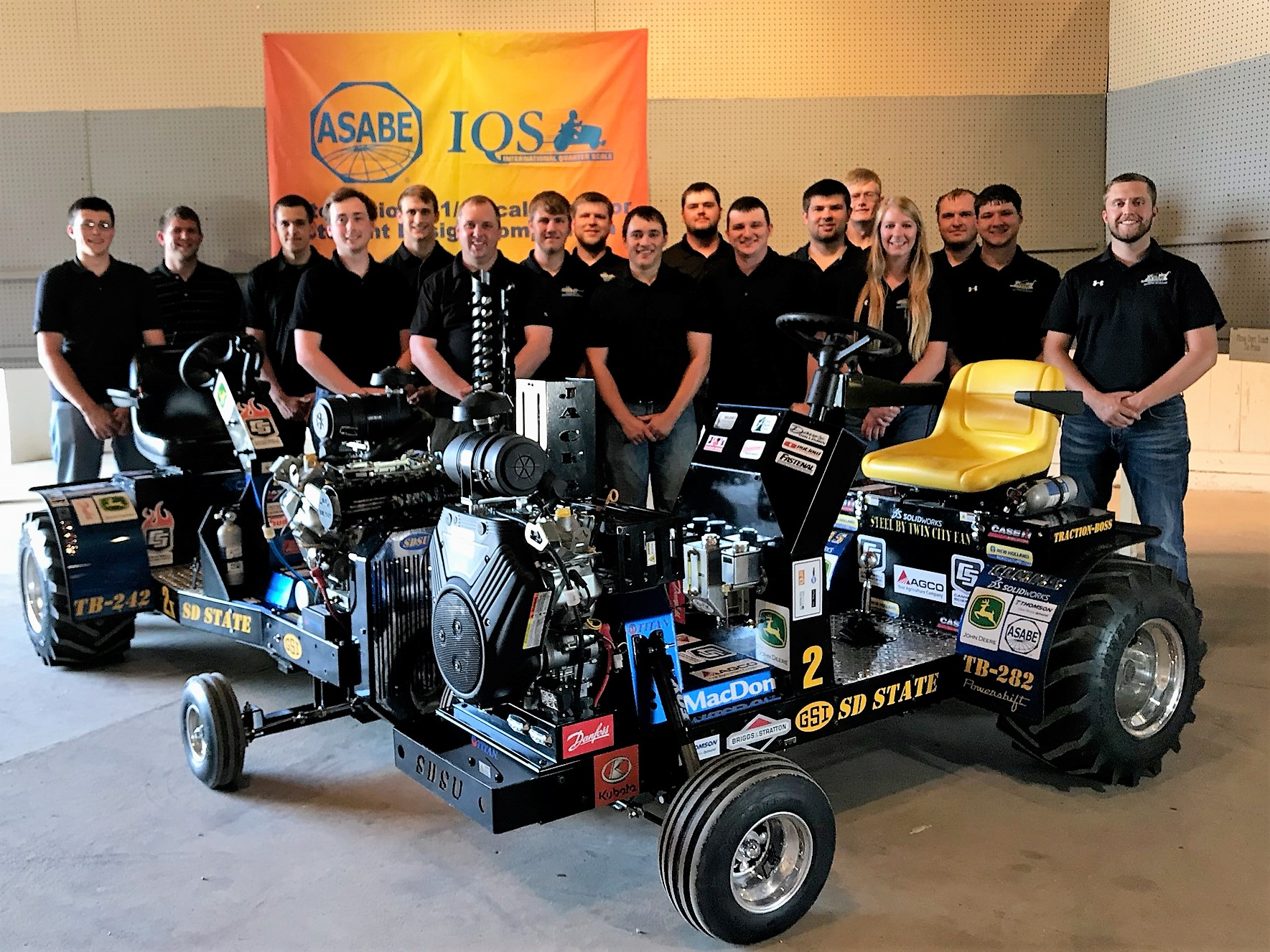 group picture of the 2018 team with their tractors