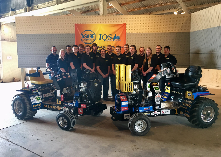 group picture of 2019 team with their tractors