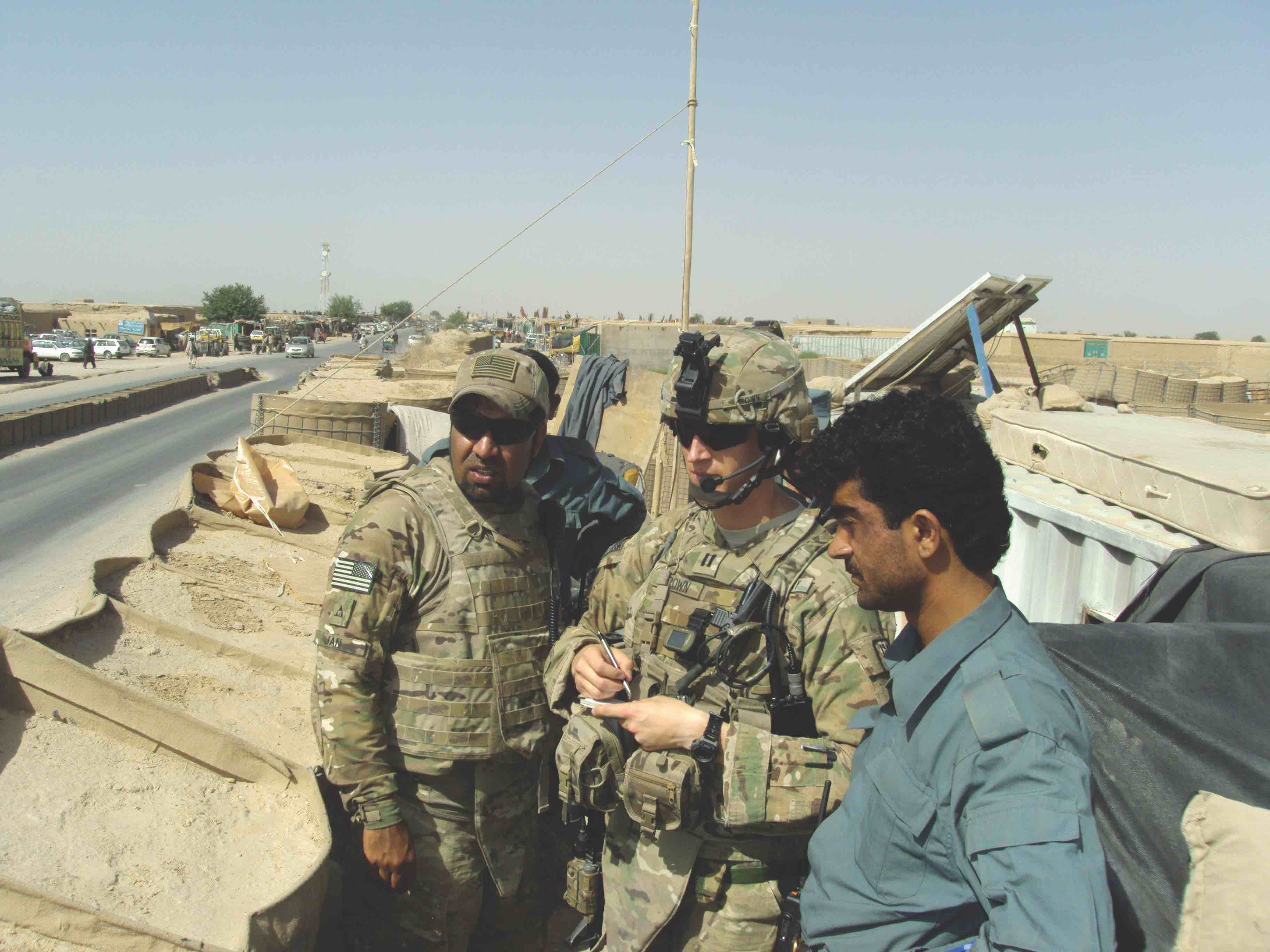 CPT Brown (center) assesses an  Afghan National Police checkpoint near Shah Joy, Afghanistan.