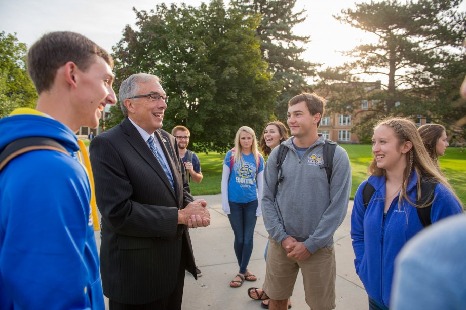 President Dunn with students on Historic Green