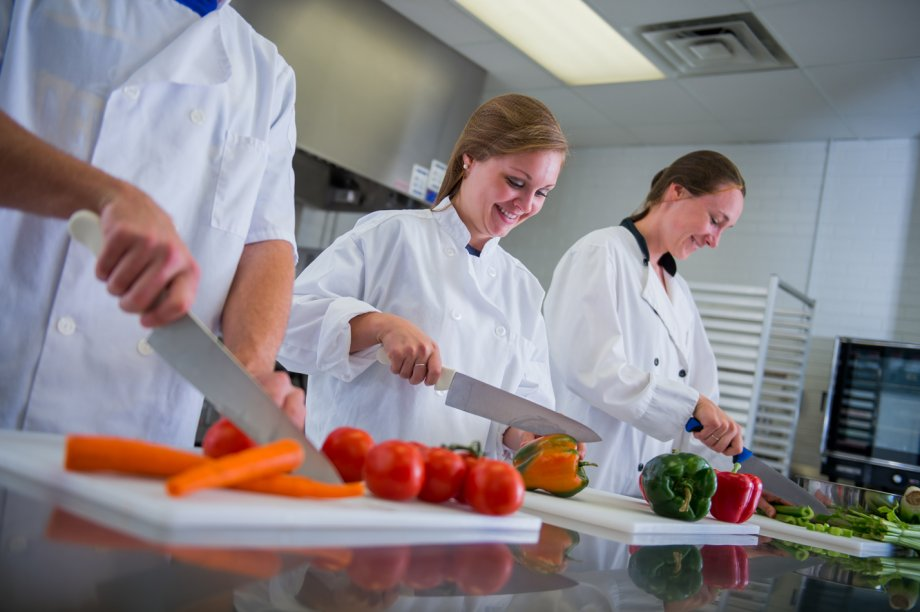 students chopping vegetables