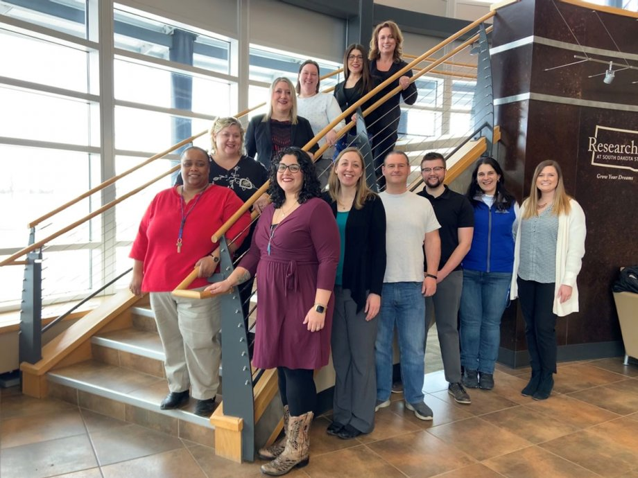Members of the Brookings Inclusive Collaborative standing on a staircase.