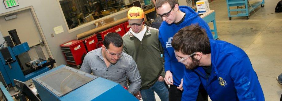"""Students using the CNC machines"""