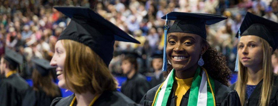 Students enter Frost arena for commencement