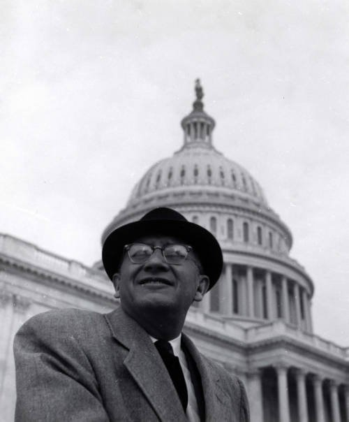Representative Ben Reifel wearing a hat and standing in front of  the capitol building in Washington, D.C.