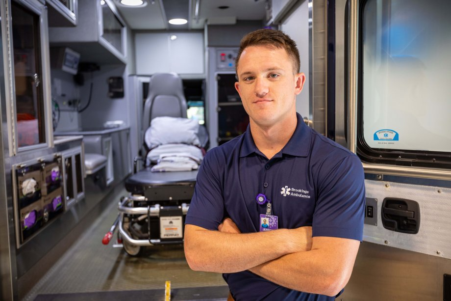 Jerrod Fedorchik stands in front of a Brookings ambulance.