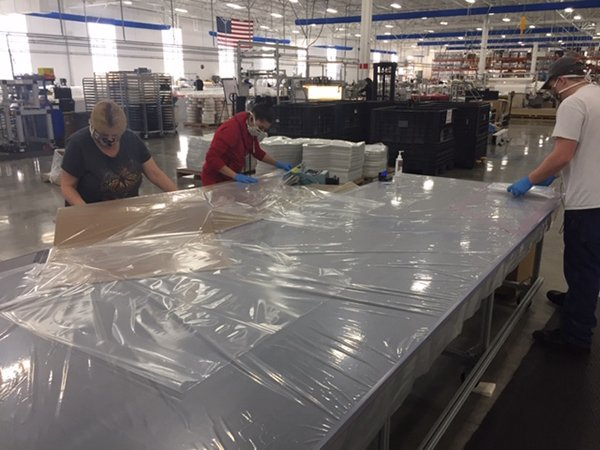 Raven Industries producing personal protective equipment gowns