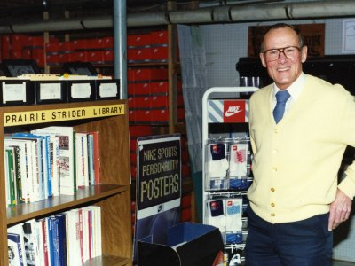 """Bob Bartling in front of the Prairie Striders Library, which was housed in the basement of Bartling's Furniture Store, 1991"