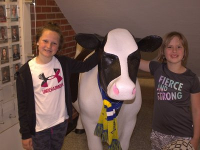 Two girls with SDSU cow