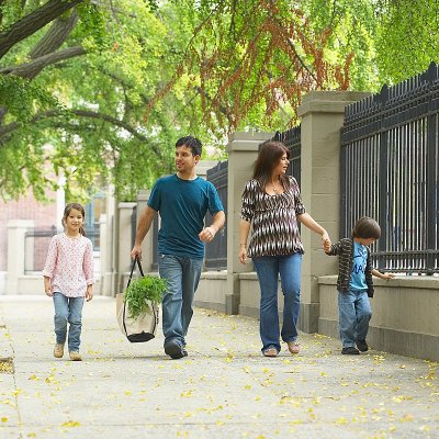Transdisciplinary Childhood Obesity Prevention Certificate - Picture of a family walking on a sidewalk.