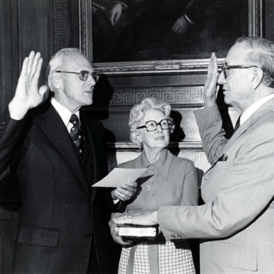 Tom Kleppe swears in Ben Reifel as Special Assistant in 1970. Frances Riefel is holding the Bible.