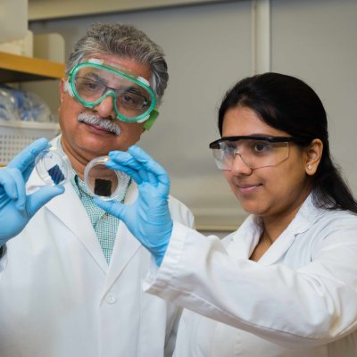 Sanjeev at the lab with a student
