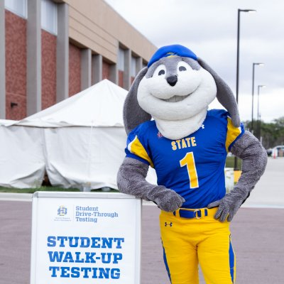Jack standing beside the Student Walk-Up Testing sign