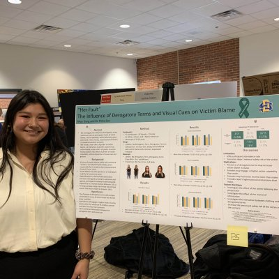 Photo of May Dang, WGSS minor, presenting research at the annual EXPL Expo