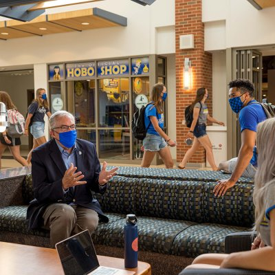 President Dunn speaking to students in the Student Union