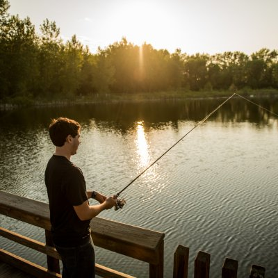 Boy fishing from a dock