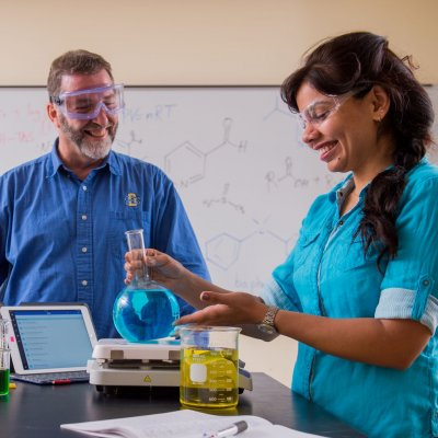 Professor and a student doing a chemistry experiment
