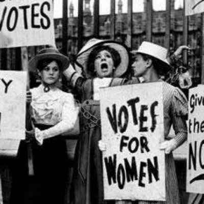 women holding signs that say votes for women