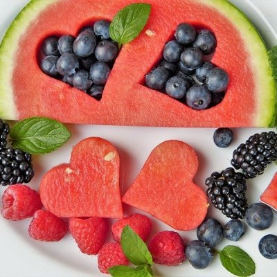 Watermelon and berries on a plate.