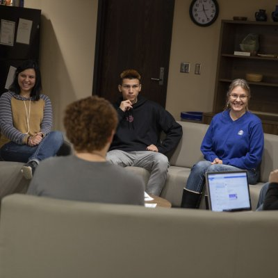 Students and faculty having a discussion