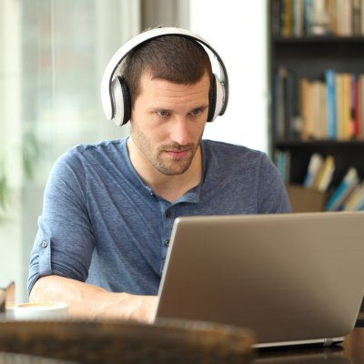 Male Studying with headphones on