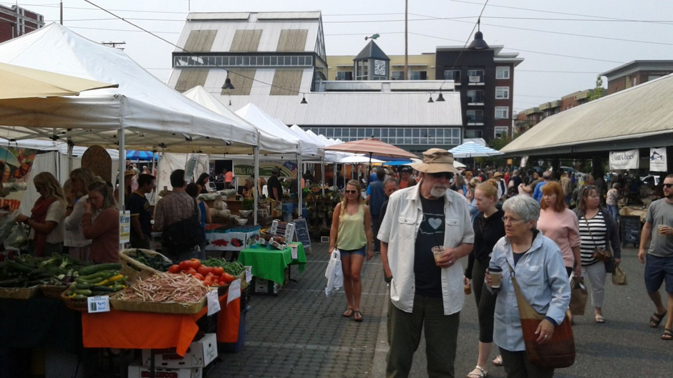 Tourists attend a farmers market