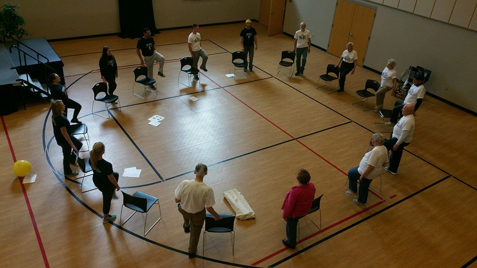 Participants participating in Physical Therapy sitting in a circle.