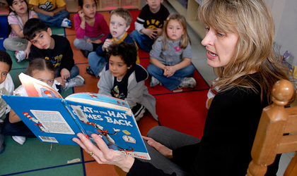Teacher reading to students in classroom.