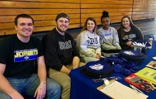 Students sitting at booth to raise awareness of Type 1 Diabetes