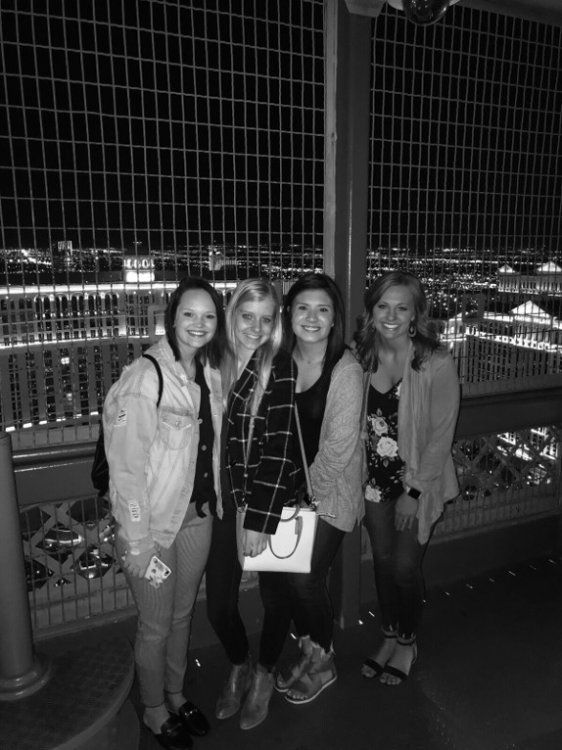 Students posing in Eiffel Tower in Las Vegas