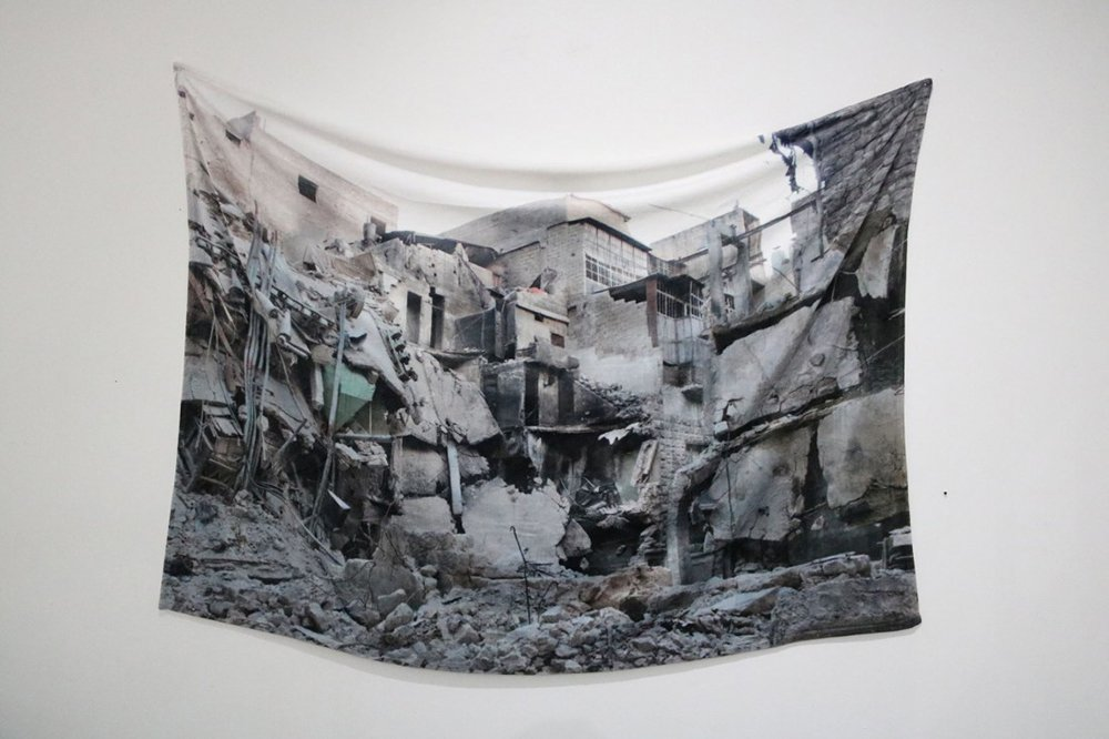 "Essma Imady, ""Receiving Blanket"" (plush blanket, image of bombed home in Aleppo)"