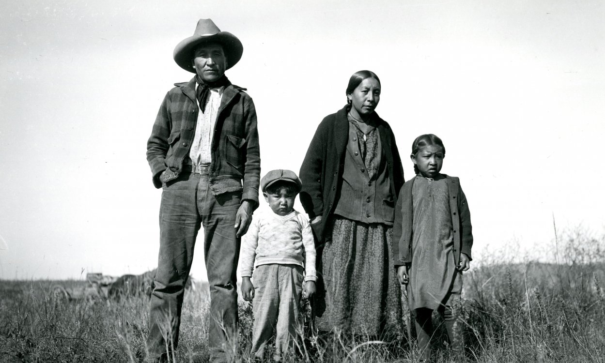 "Photograph of  ""Sam Spotted War Bonnet and Family"" by Eugene Buechel"