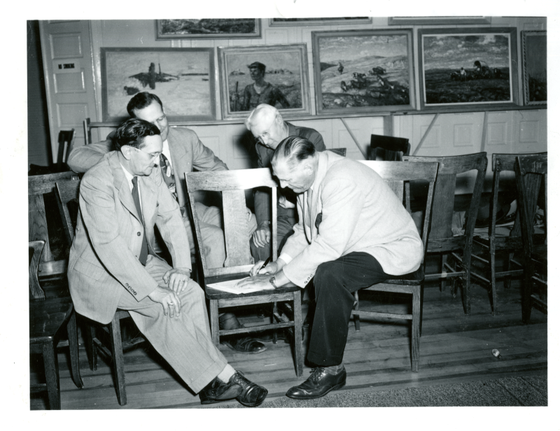 Harvey Dunn signing the letter that bequeathed his paintings to the people of South Dakota, Aug. 24, 1950