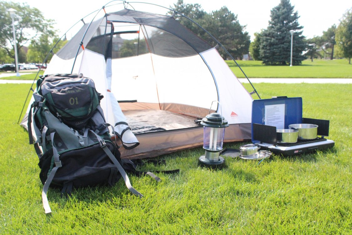 Outdoor gear rental tent, backpack, lantern, and camp stove.