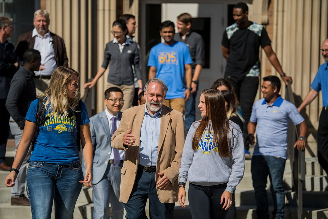 Professor walking with students
