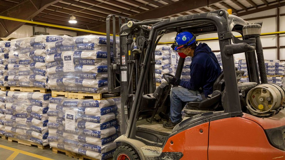 man on forklift moving 55-pound sacks of ME-PRO® on a pallet