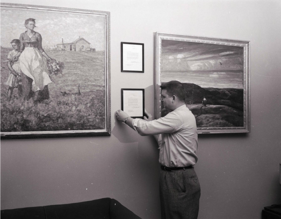 "Pugsley Union Manager Harlan R. Olson with Harvey Dunn's ""The Prairie is My Garden"""