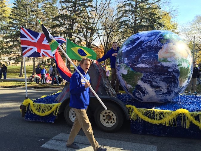 Student walking beside a Hobo Day parade float