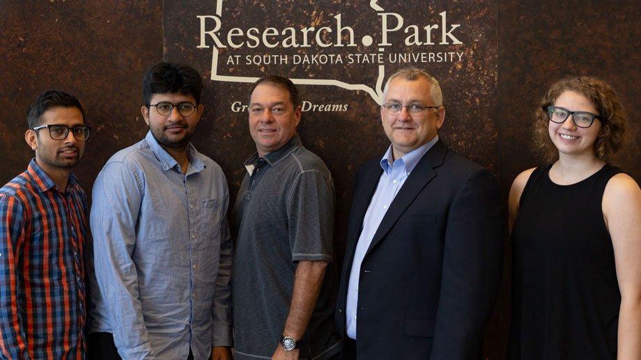 Brookings ValidFI staff with CEO Oscar DiVeroli (center)