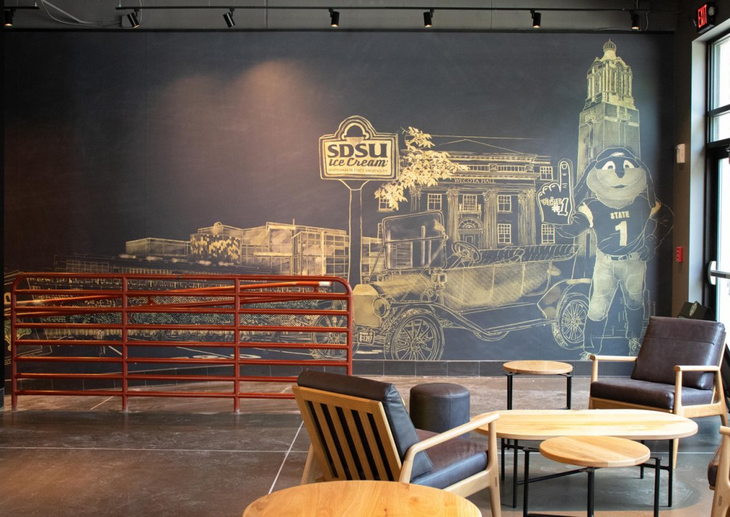 mural in Starbucks connecting to apartment building