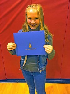 "Ellie Cruz, a fifth-grader at Estelline Elementary School, holds a certificate she received for finishing third in South Dakota State University's 16th annual ""Why I Want to be a Nurse"" essay contest."